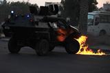 Фото дня. 16 жовтня. Авіакатастрофа у Лаосі, масові заворушення у Бахрейні та інше
